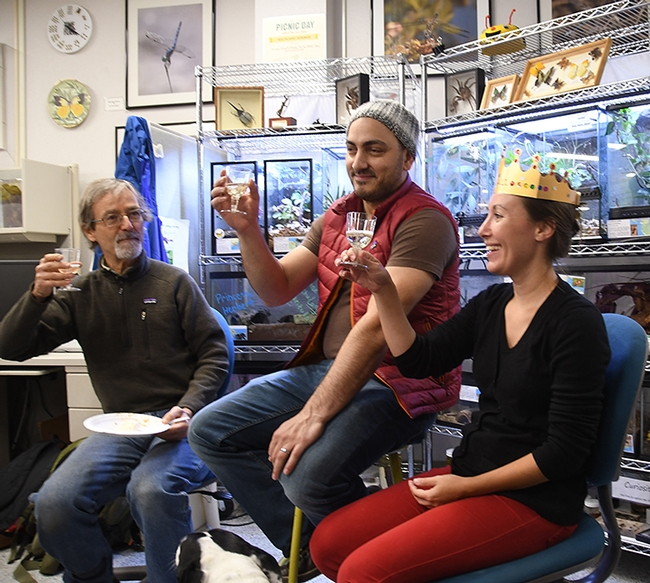 A toast! From left are Phil Ward, UC Davis professor of entomology; Amir Ghoddoucy, formerly with the California Department of Food and Agriculture; and Jessica Gillung, new Ph.D. who is heading to Cornell for her postdoctorate fellowship. (Photo by Kathy Keatley Garvey)