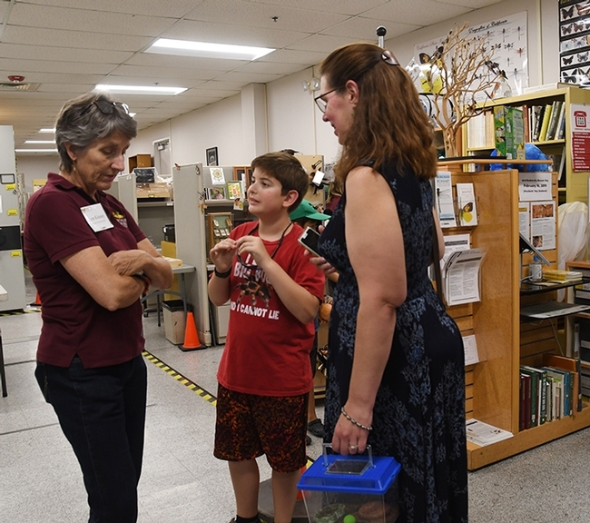 Delsin Russell of Vacaville, then  8, attended an open house last August at the Bohart Museum of Entomology with his mother, Beth. Here they chat with Lynn Kimsey, director of the Bohart Museum and professor of entomology at UC Davis. (Photo by Kathy Keatley Garvey)