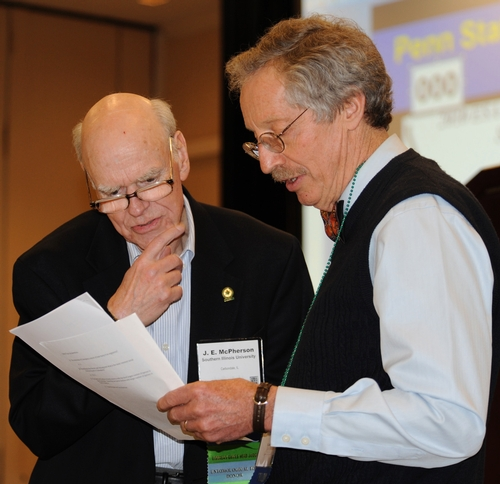 EMCEE Tom Turpin (right) of Purdue University confers with judge J. E. McPherson of Southern Illinois University. (Photo by Kathy Keatley Garvey)