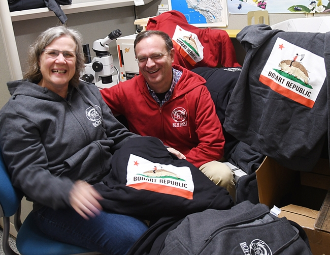 The Professors: Fran Keller, assistant professor at Folsom Lake College, and Jason Bond, Evert and Marion Schlinger Endowed Chair in Insect Systematics in the UC Davis Department of Entomology and Nematology, are surrounded by hooded sweatshirts available for sale at the Bohart Museum. Keller, who holds a doctorate in entomology from UC Davis, designed the hoodies. Bond, a spider expert, will be presenting displays at the Bohart Museum's open house on March 9. (Photo by Kathy Keatley Garvey)