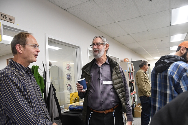 Don Miller (left), professor at Chico State University and butterfly hobbyist and ecological restorer Jeffrey Caldwell share knowledge. (Photo by Kathy Keatley Garvey)