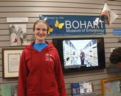 Entomologist/artist Charlotte Herbert Alberts wearing a red hooded sweatshirt: front view showing the Bohart logo and a tardigrade face. (Photo by Kathy Keatley Garvey)