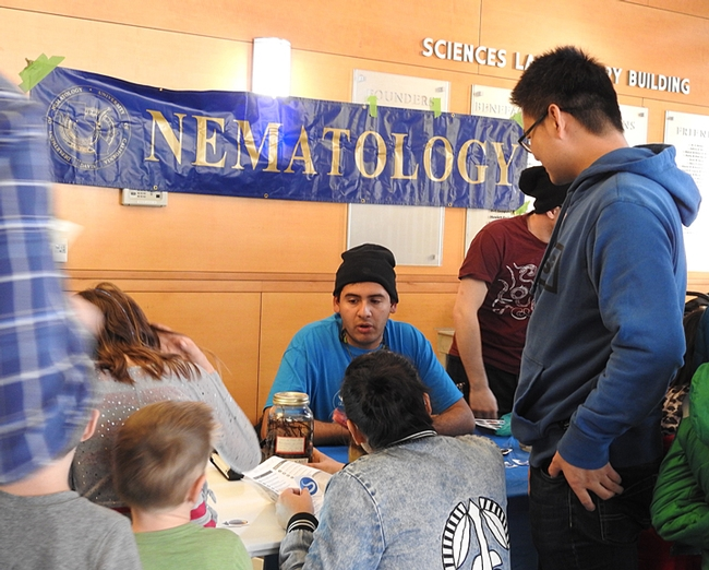 Entomologist Diego Rivera, an undergraduate student at UC Davis, chats with the crowd in the Sciences Laboratory Building. (Photo by Kathy Keatley Garvey)
