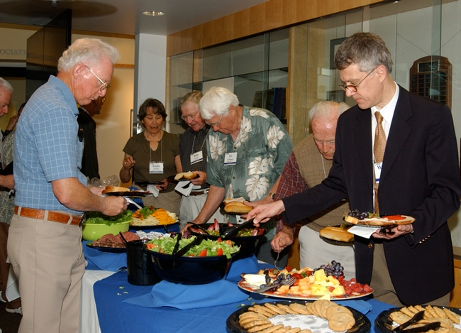 This was the scene at the 2007 UC Davis Entomology Alumni Reunion. At right is chemical ecologist Walter Leal, then chair of the Department of Entomology (now the Department of Entomology and Nematology). (Photo by Kathy Keatley Garvey)