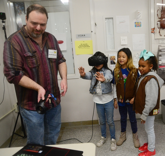 At a recent Bohart Museum of Entomology open house on spiders, medical entomologist Geoffrey Attardo demonstrated his virtual reality system. The girls, members of Brownie Girl Scout Troop 30477, Vacaville, are (from left) Jayda Navarrette, 8; Keira Yu, 8, and Kendl Macklin, 7. (Photo by Kathy Keatley Garvey)