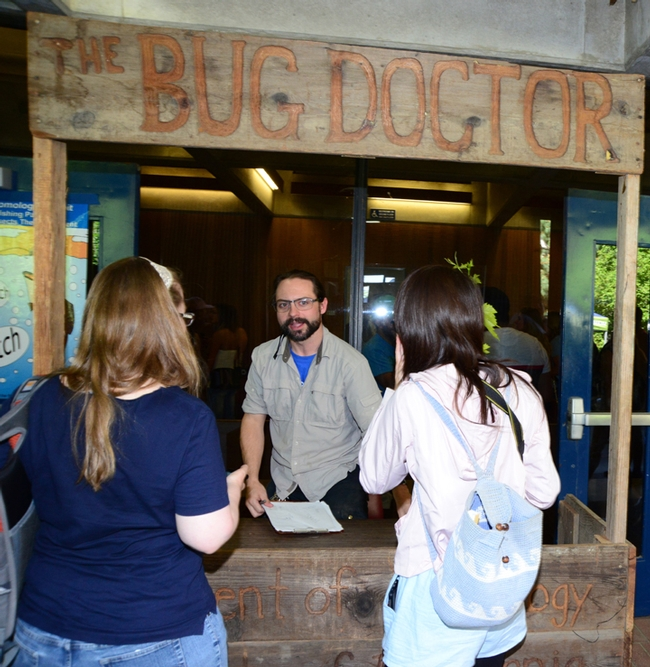 Doctoral candidate Brendon Boudinot answers questions about insects in the Bug Doctor booth at Briggs Hall. (Photo by Kathy Keatley Garvey)