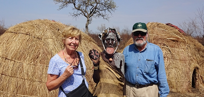 James R. Carey, UC Davis distinguished professor of entomology and his wife, Patty, with a Mursi woman (Ethiopia)  showing her lip plate. Also known as a lip disc, it is a status symbol among the Mursi women.