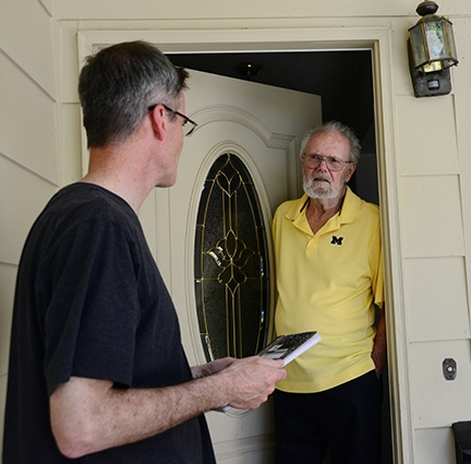 Neal Williams (left), professor of entomology at UC Davis, talks to Robbin Thorp at his home in Davis on April 24. (Photo by Kathy Keatley Garvey)