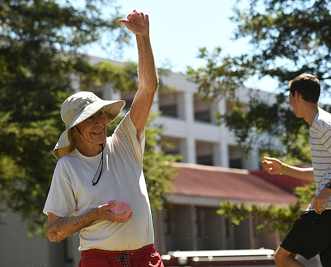 UC Davis distinguished professor Bruce Hammock catches a water balloon tossed at him. (Photo by Kathy Keatley Garvey)