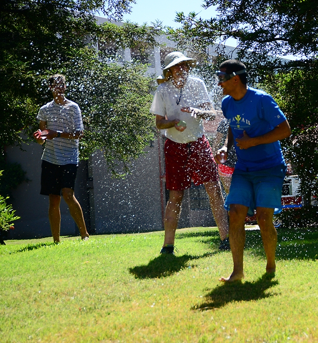 Splash! It was an international soakfest at the Bruce Hammock Lab Water Balloon Battle, with eight  countries represented. That's Hammock in the center getting sprayed. (Photo by Kathy Keatley Garvey)