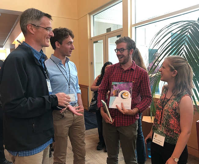 Discussing the conference are these members of the Neal Williams lab. From left pollination ecologist Neal Williams, professor, UC Davis Department of Entomology and Nematology, and Nick Rosenberger, Colin Fagan and Anna Britzman. (Photo by Kathy Keatley Garvey)