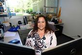Academic advisor Elvira Galvan Hack in her office in Hutchinson Hall. (Photo by Kathy Keatley Garvey)