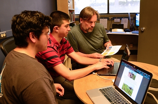 The UC Davis Smart Spray team working on their project: (from left) Gabriel Del Villar and Alexander Recalde and agricultural entomologist Christian Nansen. (Photo by Kathy Keatley Garvey)