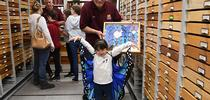Tien Ferreira, 4, of Fairfield, displays her blue butterfly cape, as Bohart associate Greg Karofelas holds a collection of blue morpho butterflies. In back is Jeff Smith, curator of the Lepidoptera section. (Photo by Kathy Keatley Garvey) for Bug Squad Blog