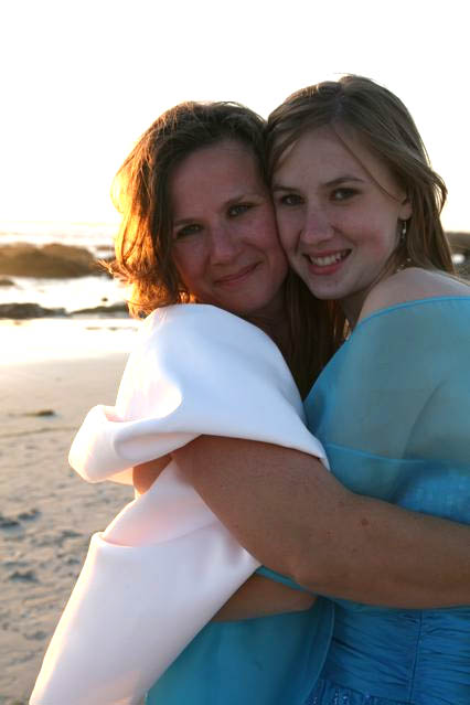 Entomologist Fran Keller (left) and daughter Rachael deVries share a hug on the beach after Fran's recent wedding to entomologist Pat Randolph. Yes, Fran collected insects along the beach. (Photo by Cory Unruh)