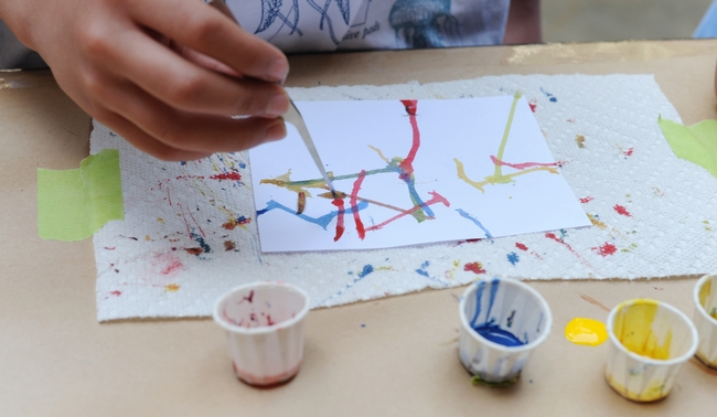 Children especially love Maggot Art. They dip the maggots into water-based paint and let the larvae crawl on the paper. (Photo by Kathy Keatley Garvey)