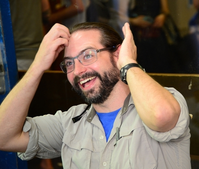 Brendon Boudinot reacts after listening to a question at the Entomological Society of America's Linnaean Games, now the Entomology Games. (ESA Photo)
