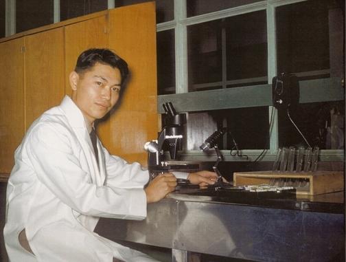 Medical entomologist Lt Robert Washino working in a lab south of Paris during the Korean War.
