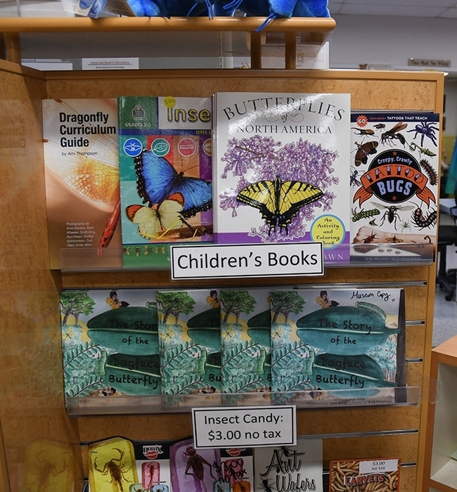 Books for all ages are shelved in Bohart Museum's gift shop, now online. (Photo by Kathy Keatley Garvey)