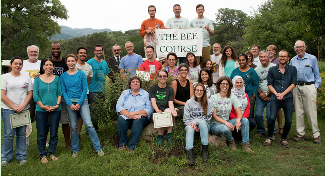 In this 2015 Bee Course class photo, Charlie Nicholson (top, far left) holds the sign. In the second row, far left, is co-instructor Robbin Thorp, UC Davis distinguished emeritus professor of entomology. Nicholson is the winner of the inaugural Robbin Thorp Memorial First-Bumble-Bee-of-the-Year Contest, sponsored by the Bohart Museum of Entomology. (Photo courtesy of The Bee Course)