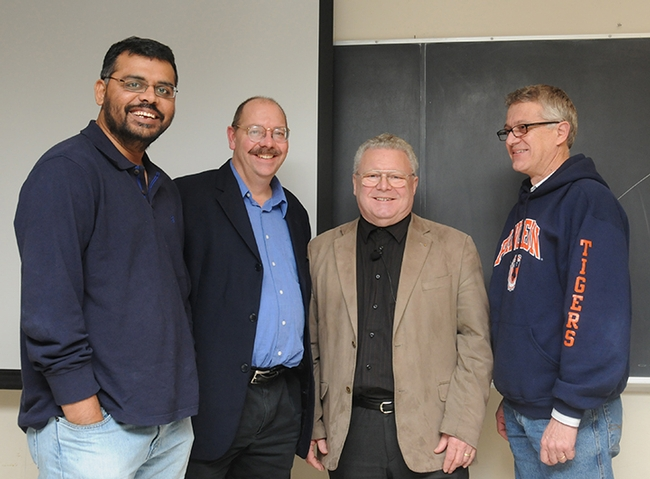 Renowned organic chemist Wittko Francke met with UC Davis researchers following his Dec. 8, 2010 presentation. From left are chemical ecologist Zain Syed of the Walter Leal lab; chemical ecologist and forest entomologist Steve Seybold (1959-2019) of the USDA Forest Service, Pacific Southwest Research Station, and the UC Davis Department of Entomology and Nematology; and UC Davis chemical ecologist Walter Leal. (Photo by Kathy Keatley Garvey)