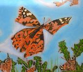 A painted lady, Vanessa cardui, flutters away in this prize-winning work of artist Roberto Valdez. He won best of show in the professional fine arts category, oils and acrylics, at the 2021 Dixon May Fair.