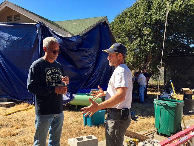 In this image, taken in October 2018, consultant and mentor Vernard Lewis (left), confers with Andrew Sutherland,  UC integrated pest management advisor for Bay Area counties,  about the Villa Termiti at the UC Berkeley Field Station. Sutherland, who holds a doctorate in entomology from UC Davis,  was recently awarded state funding to remodel the Villa for future training of pest management professionals in the state.(UC ANR Photo by Pam Kan-Rice)