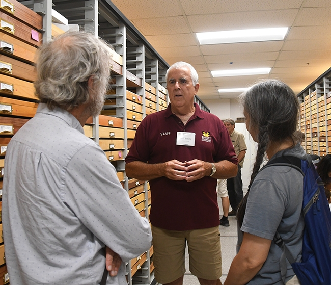 Entomologist Jeff Smith (center) discusses the difference between moths and butterflies at a Bohart Moth Night. (Photo by Kathy Keatley Garvey)