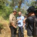 California dogface butterfly expert Greg Kareofelas (far left) chats with Rob Steward of the PBS program,