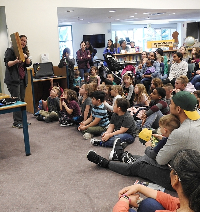 Tabatha Yang, the Bohart Museum of Entomology's education and outreach coordinator, shows a display of insects at a Vacaville Public Library event. The Bohart is in need of traveling display boxes and is raising funds. (Photo by Kathy Keatley Garvey)