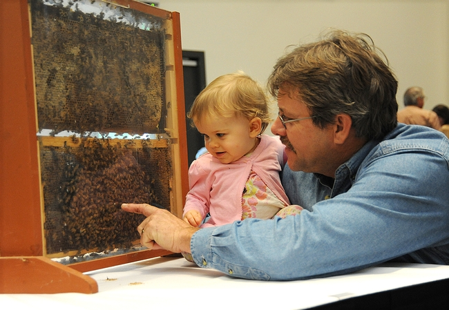 Future beekeeper Emily Fishback with her beekeeper-father Brian Fishback of Wilton, who provided the bee observation hives. (Photo by Kathy Keatley Garvey)