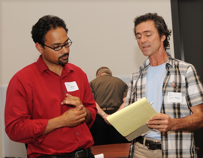 UC Davis assistant professor Brian Johnson (left) answers a question from beekeeper Clay Ford of Vacaville. (Photo by Kathy Keatley Garvey)