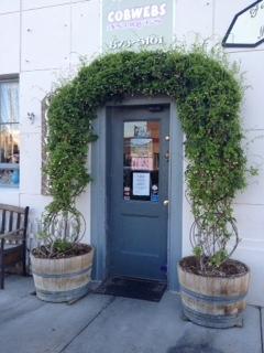 Akebia vine surrounding a door.