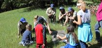 California Conservation Corps members at the UC ANR Hopland Research & Extension Center show a group of kids how to find herpetofauna like salamanders and skinks for a citizen science wildlife monitoring project. for California Naturalist Blog