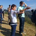 Nell Green Nylen (right) and her colleagues stop for a view of San Francisco Bay on a hike in the East Bay Hills above the UC Berkeley campus. Photo by Lidia Cano Pecharromán.
