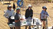 UC Santa Cruz Hydrogeology team members collect fluid samples during experiments at a managed aquifer recharge site. From left to right: Professor Andrew Fisher, graduate students Galen Gorski and Sarah Beganskas, and undergraduate student Dominique van den Dries. Photo courtesy of UCSC Hydrogeology and The Recharge Initiative.