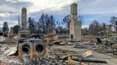 In a Santa Rosa neighborhood, all homes were burned down to the foundations with only things like fireplaces, washer dryer sets, and car frames left. Photo by Faith Kearns.