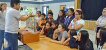 Dr. Sam Sandoval shows afterschool program youth a groundwater model. Photo by Marianne Bird. for The Confluence Blog