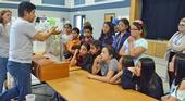 Dr. Sam Sandoval shows afterschool program youth a groundwater model. Photo by Marianne Bird.