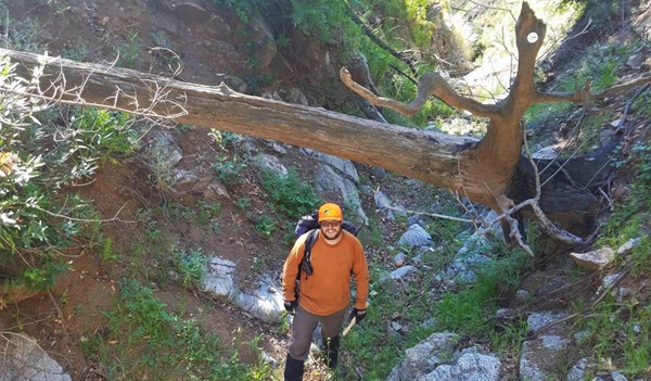 Graduate student Nathan Jumps revisiting Englewild Canyon to collect additional sediment samples. Photo by A. Gray.