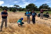 Maggie Reiter with stakeholders on a naturalized area of a golf course. Photo by James Hempfling.