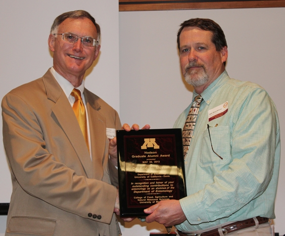 Eric Mussen (left) receives the Alexander Hodson Graduate Alunmi Award from Bill Hutchison, professor and chair of the University of Minnesota's Department of Entomology. (Courtesy Photo