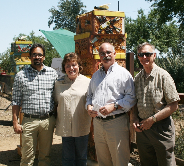 State Regent Debbie Jamison with members of the UC Davis Department of Entomology and Nematology. From left are bee scientist Brian Johnson, assistant professor of entomology; Debbie Jamison; Ed Lewis, professor and vice chair of the department; and Extension apiculturist Eric Mussen. (Photo by Martha Ozonoff)