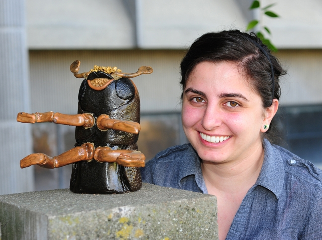 Kristina Tatiossian with the ceramic bark beetle she sculpted. (Photo by Kathy Keatley Garvey)