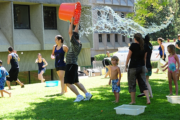 Research scientist Sung Hee Hwang splashes water on Cindy McReynolds and Louisa Lo. In front is Louise Bouchet, a visiting student from France. (Photos by Kathy Keatley Garvey)