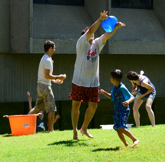 Christophe Morisseau catches a blue water balloon In the background is Bogdan Barnych, husband of Natalie Vasylieva (she is a postdoc in the Hammock lab). In the foreground:  Adele Fargues, visting student from France, and Garrett Kamita.