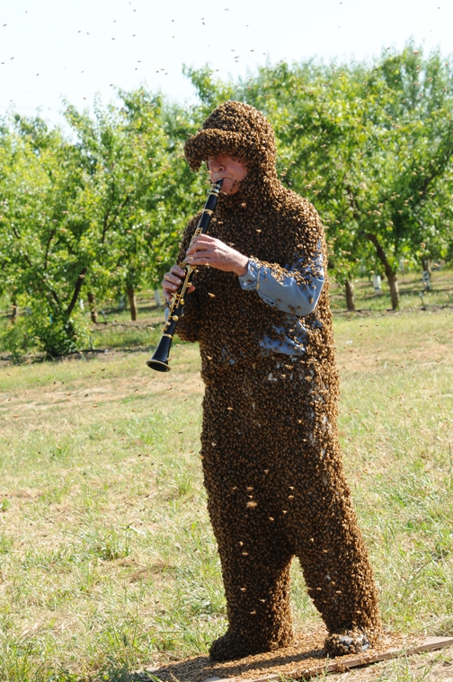 Norm Gary playing B-flat clarinet while wearing his bee suit. (Photo by Kathy Keatley Garvey)
