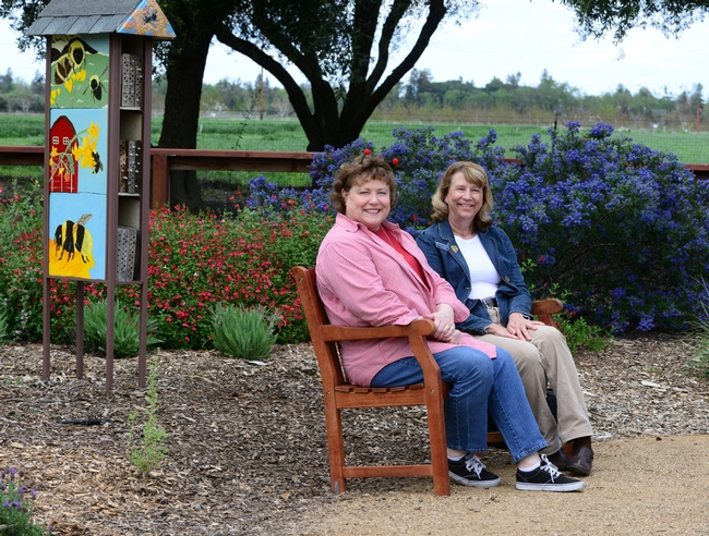 State Regent Debra Jamison (left) and State Treasurer Gayle Mooney share a bench donated by the California State Society of the Daughters of the American Revolution.