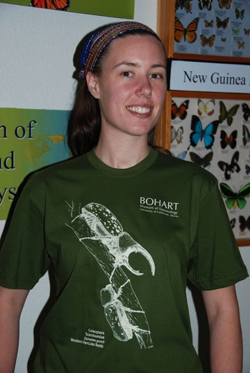 Artist Courtney Lambert wearing the Bohart Museum of Entomology t-shirt. She drew the Western Hercules beetles. (Photo by Fran Keller)