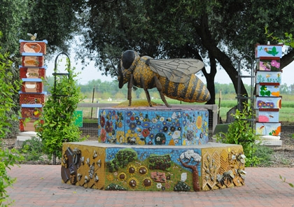 This is the bee sculpture created by artist Donna Billick, co-director and co-founder of the UC Davis Art/Science Fusion Program. The columns of bee hives are the work of the Art/Science Fusion Program. (Photo by Kathy Keatley Garvey)